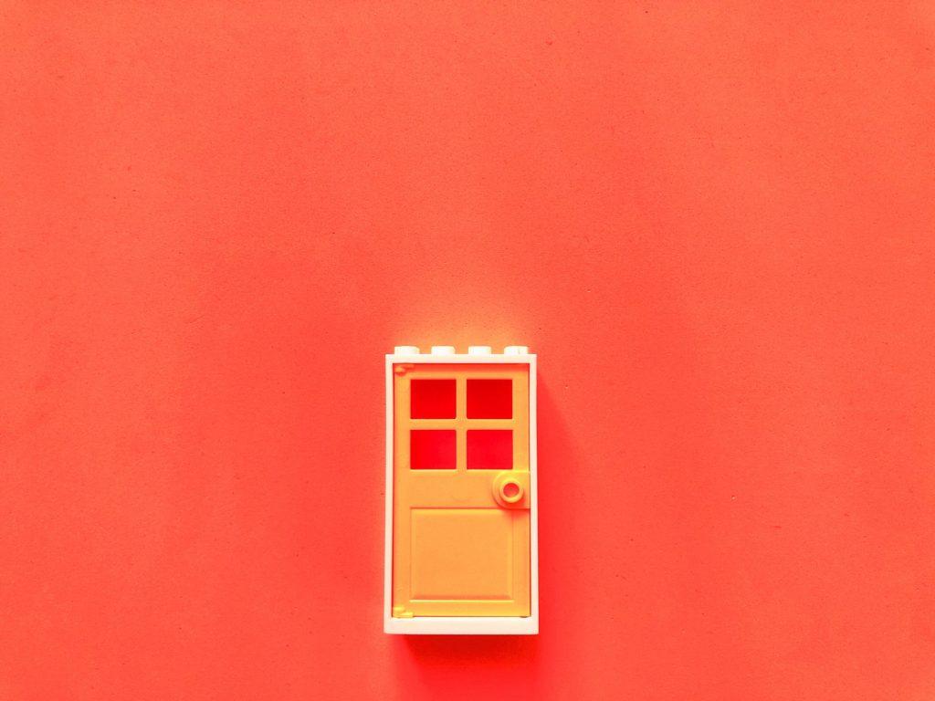 Orange door and house
